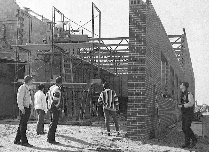Students observe the ongoing construction of the new NDHS gymnasium in 1964